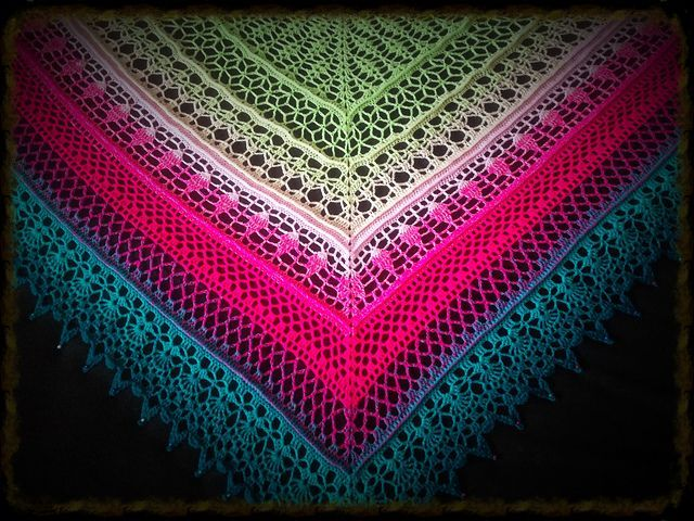 Well, I checked and I double-checked and I triple-checked. Yes, indeed. This IS crochet and it IS free and it IS quite possibly the most stunning thing I have seen in awhile.  First, you've got that gorgeous very long self-striping yarn. It's a light fingering weight so you can get a lot of differ