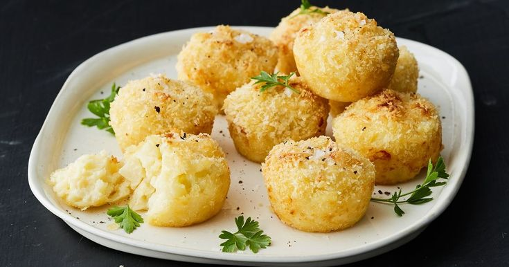 We've taken one of your favourite family weeknight dinners and made it into a crispy ball of risoni, cheese and cauliflower.