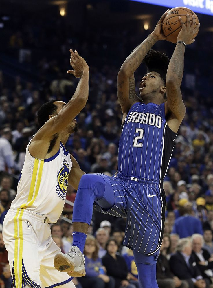 Orlando Magic's Elfrid Payton (2) shoots over Golden State Warriors' Shaun Livingston, left, during the first half of an NBA basketball game Monday, Nov. 13, 2017, in Oakland, Calif. (AP Photo/Ben Margot)