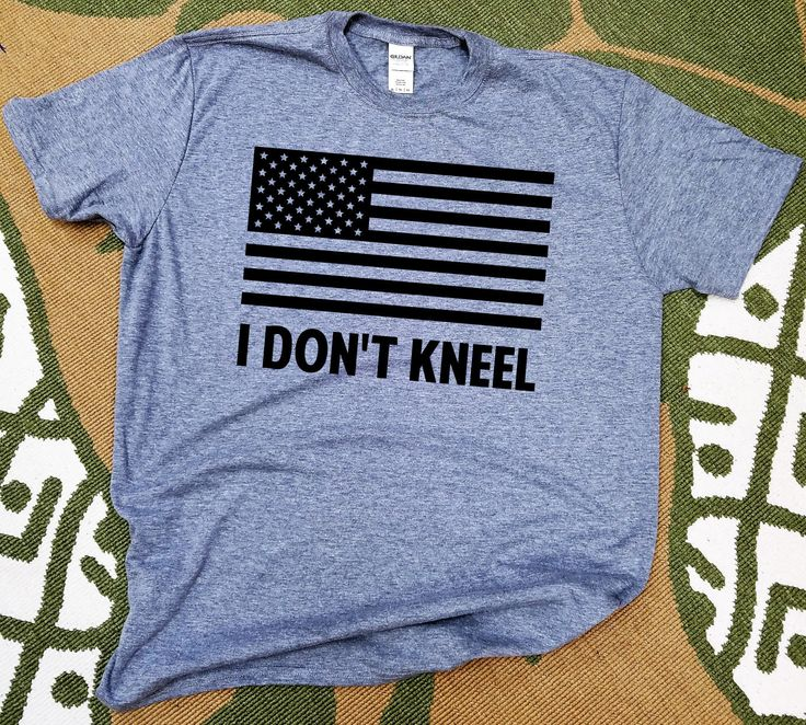 I DON'T KNEEL with American Flag tshirt. Show your support for standing during the National Anthem with this t-shirt.  Gildan t-shirts with black or white design.