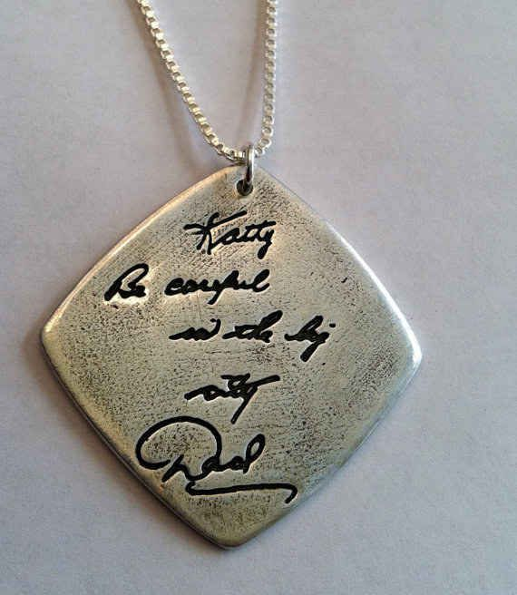 A pendant with an engraved message in a loved one's handwriting.