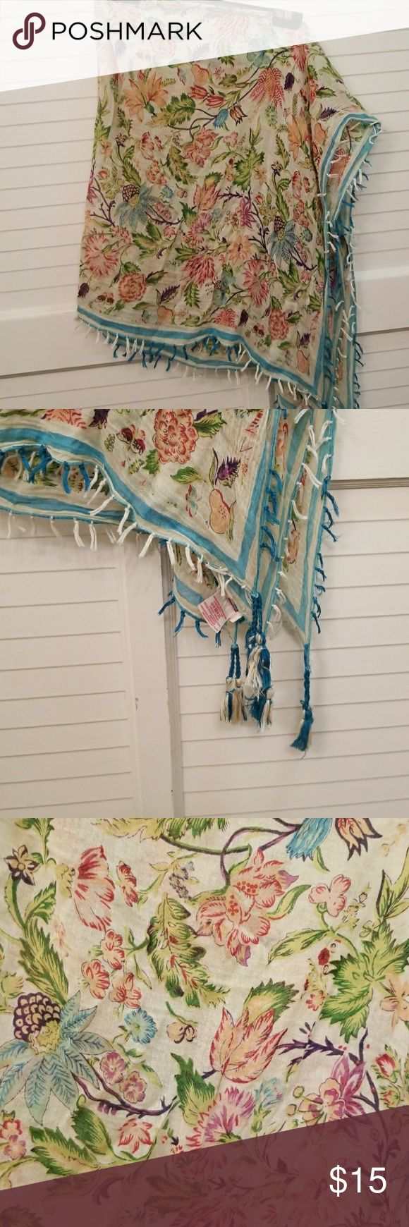 Anthropologie square scarf thin floral with tassle Anthropologie square scarf thin floral with tassels. Photo is the scarf folder in 4s Anthropologie Accessories Scarves & Wraps