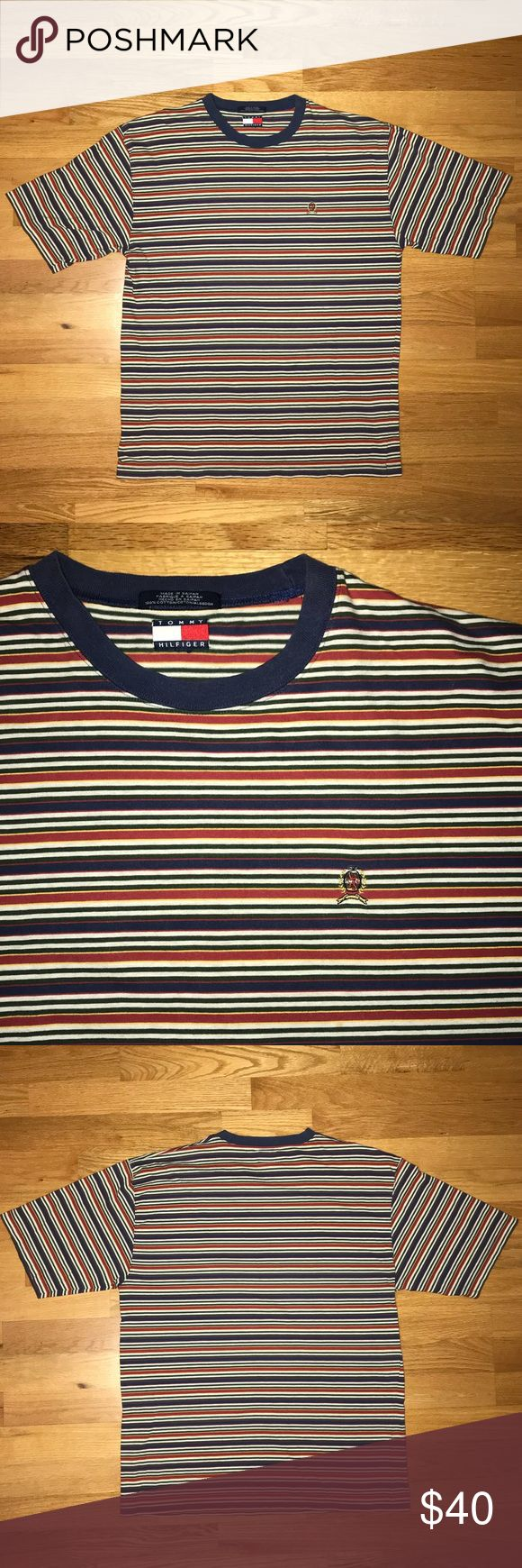 Vintage Tommy Hilfiger Striped T Shirt Very stylish striped t shirt from Tommy Hilfiger. Blue, Red, Green, Yellow and white stripes go well together with anything. Tommy crest on chest and flag on neck. Tommy Hilfiger Shirts Tees - Short Sleeve