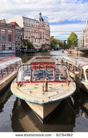 Moored cruise-boat in the old town of Amsterdam