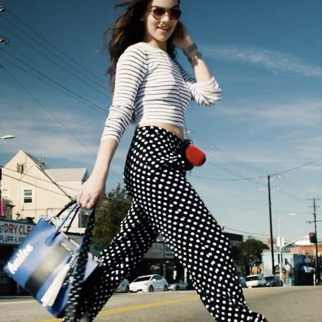 Actor and musician @HaileeSteinfeld stops traffic on the streets of LA with our Mercer tote in Michael Kors The Walk.  Watch her video then join us on the streets to get #SidewalkSpotted.