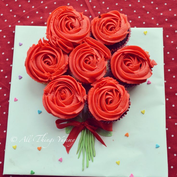 """The first in our Valentine day lineup: """"Red roses cupcake bouquet!!"""" """"Roses are red, violets are blue, get your valentine these cupcakes and we will love you :) """" #valentines #valentinesday #cupcakes #cupcakebouquet #leaves #flowers #bouquet #icing #rosettes #rose #ribbon #vday #vdaydesigns #customised #love #romance #hearts #atyummy #red"""