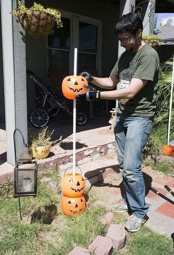 When we first saw his bucket full of plastic pumpkins, we weren\u0027t - best decorated houses for halloween