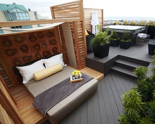 Rooftop deck, hot tub, and outdoor lounger all in one--this is perfect
