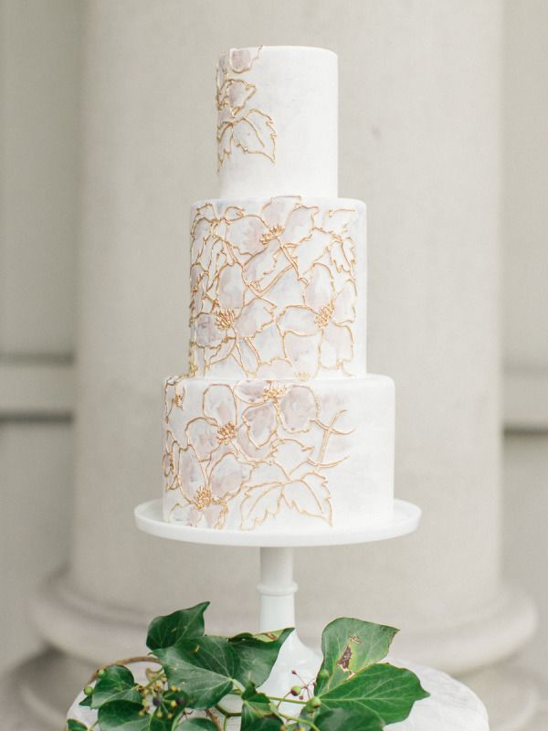 Watercolor flowers detailed with gold: http://www.stylemepretty.com/2015/06/14/wedding-cakes-almost-too-pretty-to-eat/