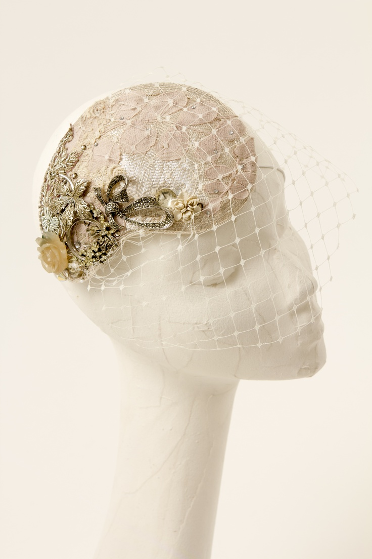 https://www.etsy.com/listing/122973897/silver-and-cream-bridal-headpiece-with