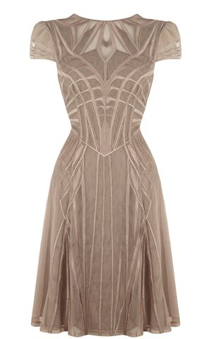 Karen Millen. Cross between the 1920s and 1940s.  Like the structural lines following the form.*