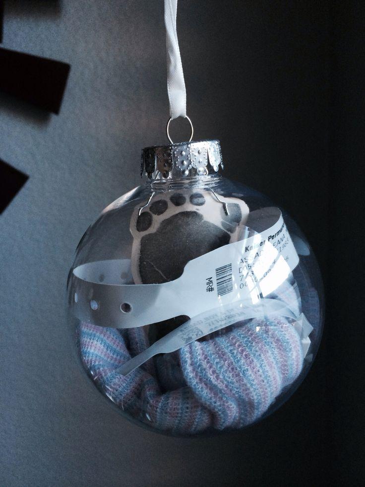 Christmas ornament for newborn keepsake. Hospital bracelets, beanie, and ink footprint