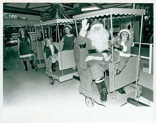 Santa and Chimp at Park Royal Shopping Centre, 1960s. (Photo via West Vancouver Archives)