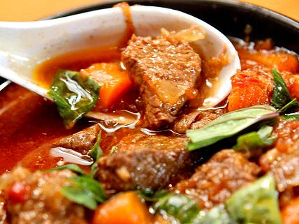 Bò Kho is a traditional Vietnamese beef stew. It's comfort food. Probably every Viet kitchen has its own version. This version is a combination of the basics. It's not as thick as an American stew, but more hearty than a soup with beef, carrots, and traditional Viet flavors like bay leaf, ginger, and anise. Sop up the rich broth with a French baguette like the Vietnamese do or serve with rice.