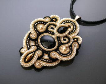 Beautiful, impressive soutache necklace, made of soutache strings with Hematite, Mother of Pearl and glass beads.  Necklace have been impregnated.  Full length: 3.6 inches.  Length of string: 19.2 inches  Colour: gray, graphite, silver and light golden.