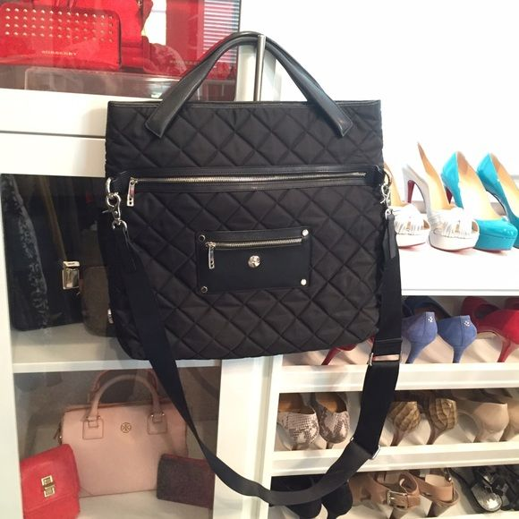 Knomo Quilted Black Laptop Bag Brand new condition large laptop bag. I used this to put my books and laptop in while completing my Master's. Nylon and leather. Interior is a bright pink and in pristine condition. Outside shows no wear signs. Knomo Bags Laptop Bags