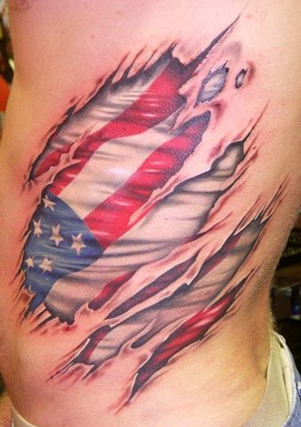 Rippped skin american flag Ripped skin reveals an American flag tattoo.