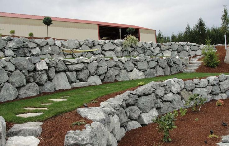 17 best images about rock wall ideas on pinterest for Rock wall garden