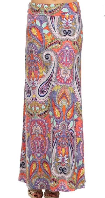 This pink and purple paisley pattern stands out in this vibrant maxi skirt. The foldable waistband can be unfolded to add length for taller girls. Material is a stretchy rayon/spandex combo. Size char