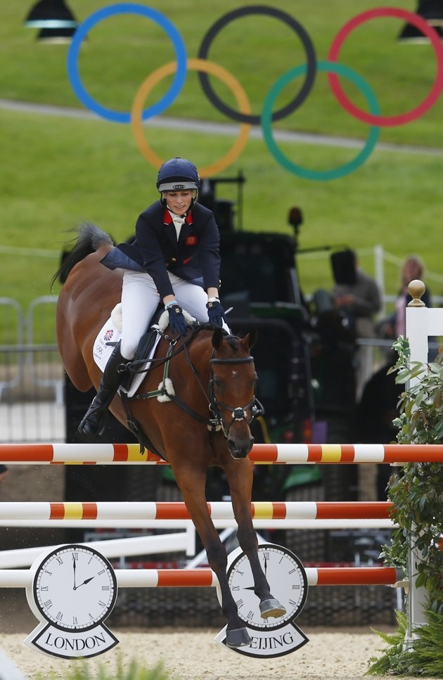 Day 4: Britain's Zara Phillips, riding High Kingdom, clears a fence during the Eventing Jumping equestrian event at the London 2012 Olympic Games in Greenwich Park, July 31, 2012. (Reuters)