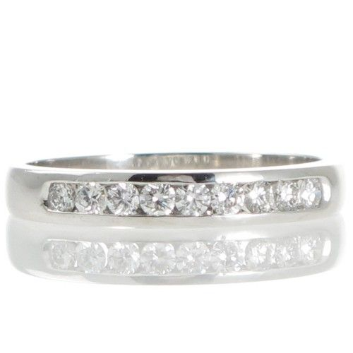 An 18ct White Gold Diamond Band. View our collection of modern and antique gold, platinum, and gem-set rings to mark any celebration at www.rutherford.com.au
