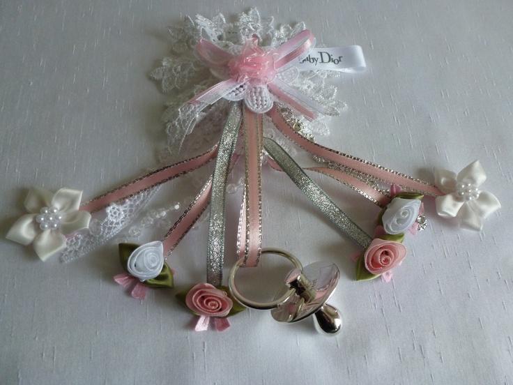 Pram hanger with nice ribbon trims & dummy.