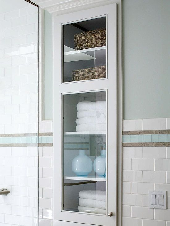 built between wall studs, behind the door in the tiny bath. This storage unit doesn't take up an inch of floor space. cabinet is recessed into the wall to boost storage in a small bathroom . To make it uber-cheap, you could use a sturdy, reinforced picture frame/glass for the door. The glass is a lot thinner, so not for households with wee ones that tend to slam!