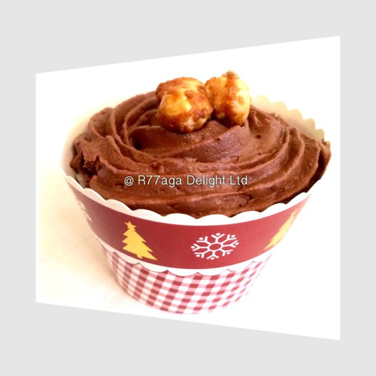 Chocolate cupcake topped with Ferrero Roche buttercream & garnished with caramelised hazelnuts.
