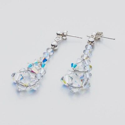 Swarovski Bicone Earrings 45mm Crystal AB  Dimensions: length: 4,5cm stone size: 4 and 6mm Weight ( silver) ~ 0,90g ( 1 pair ) Weight ( silver + stones) ~ 3,90g Metal : sterling silver ( AG-925) Stones: Swarovski Elements 5328 4 & 6mm Colour: Crystal AB 1 package = 1 pair  Price 7 EUR