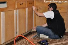 "Add dimension to flat cabinet fronts!  We bought ""under layment"" intended for under hardwood floors.  This board is about an 1/8 of an inch thick and is found near the plywood..."