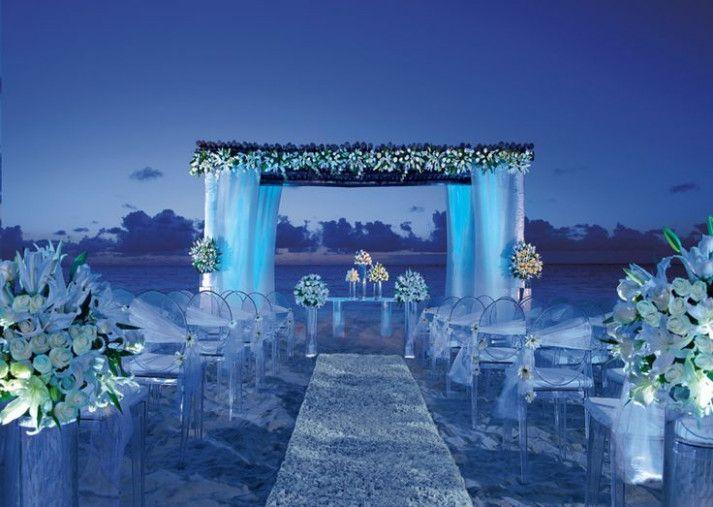 Destination Wedding Decorations On The Beach Night Beach Weddings Beach Wedding Decorations Blue Wedding Decorations