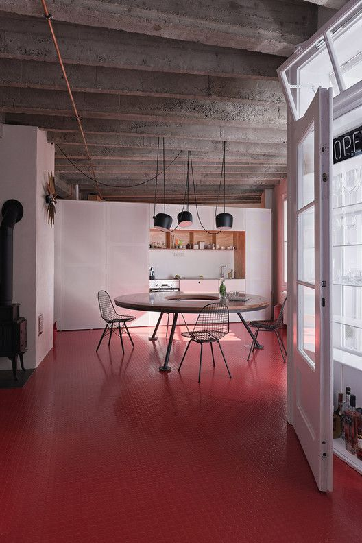 open floor plan | natural light loft | #red floor | © Peter Čintalan