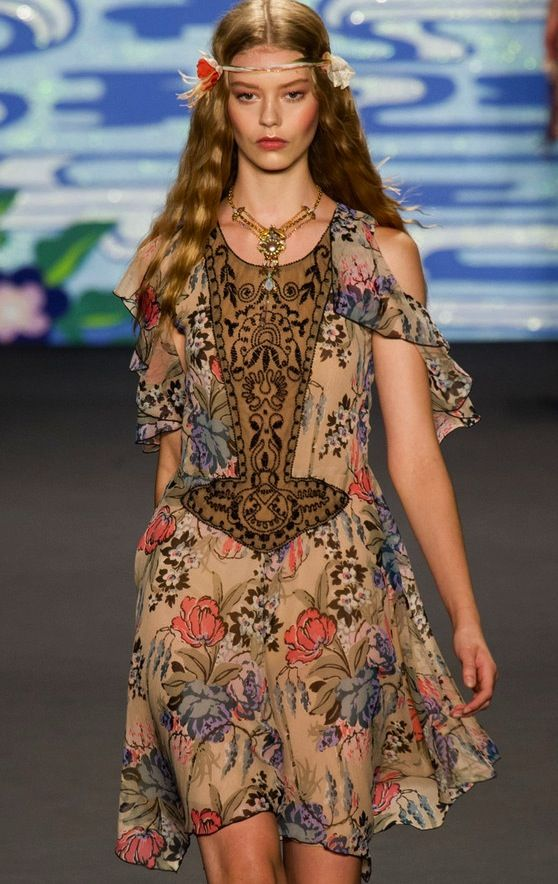 Anna Sui Spring 2014. Free. Renee isn't scared of short dresses at all.