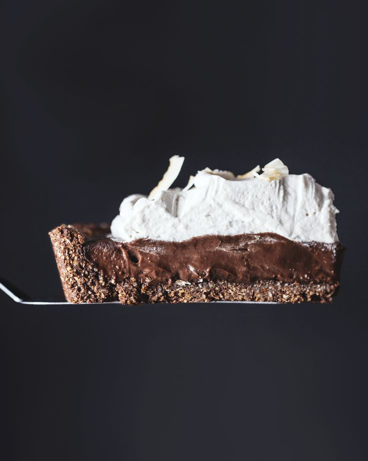 This pie is what dreams are made of. A chocolate hazelnut crust filled to the brim with creamy chocolate and topped with fluffy coconut whipped cream. No dairy or flour, and no refined sugar! Vegan & Gluten Free.