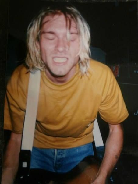 Kurt Cobain in what I first thought was big suspenders but its just a guitar strap