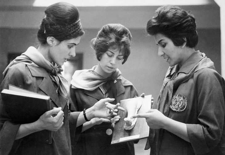 Two medical students listen to their professor's explanation of a model of a human limestone cast. The students were part of the Faculty of Medicine in Kabul, Afghanistan in 1962, when the state was a form of democracy.