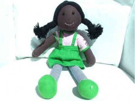 "Cuddly 12"" Rag Doll - West Indian Girl With Plaits - Look at this stylish little rag doll, she comes with a removable bright green dress, a light pink t-shirt and striped tights. Her skin is dark brown and she has long black hair- lucky for you she loves people playing with her hair!"