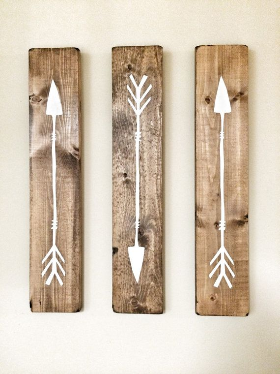 These Rustic Wooden Arrows are a unique piece for your home, nursery or office! This listing is for three white arrows on walnut stained wood pieces The wood has been sanded smooth, stained, painted & distressed by hand for that perfect rustic touch Measurements: each arrow is 18 x 3.5 Each arrow has a brass plated tooth hanger on the back for easy hanging! *please note that each arrow is handcrafted and the stain varies in shade from a lighter to darker tone www.cherrytreegallery.etsy.com