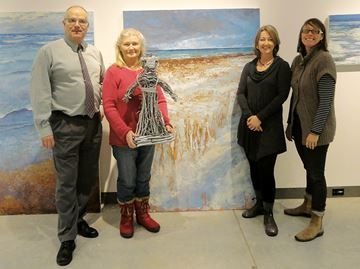 """Exhibition opens Friday at Quest gallery in Midland - Peter Mount, left, branch manager of BrokerLink and sponsor of the upcoming Quest Art School and Gallery exhibition """"From Sky to Shore,"""" chats with artists Halyna Mordowanec-Regenbogen and Sue Miller and Quest curator Jill Price."""