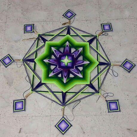 New yarn mandala in progress, with eight little mandalas