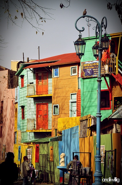 The neighborhood, La Boca, Buenos Aires, Argentina. La Boca is a bit of an odd fish. It's fiercely and unreservedly working class and down-at-heel, yet it has a couple of very, very popular tourist attractions.