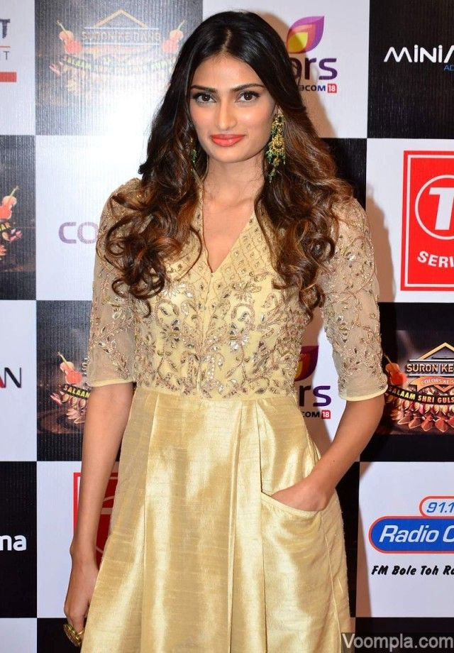 Athiya Shetty in a gold Anita Dongre dress