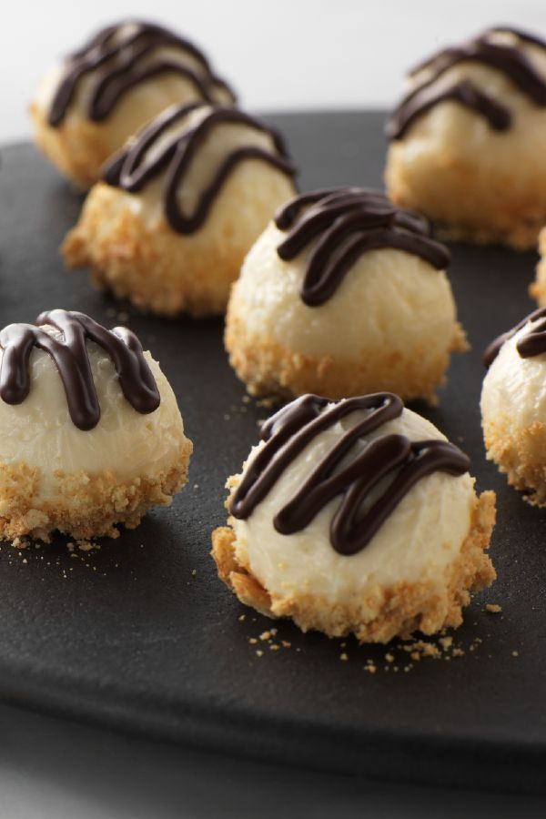 No-Bake Cheesecake Truffles – This chocolate-drizzled dessert recipe can be customized to your taste! Substitute your favorite ingredients, such as finely chopped Halloween candy bars, for the graham cracker crumbs.