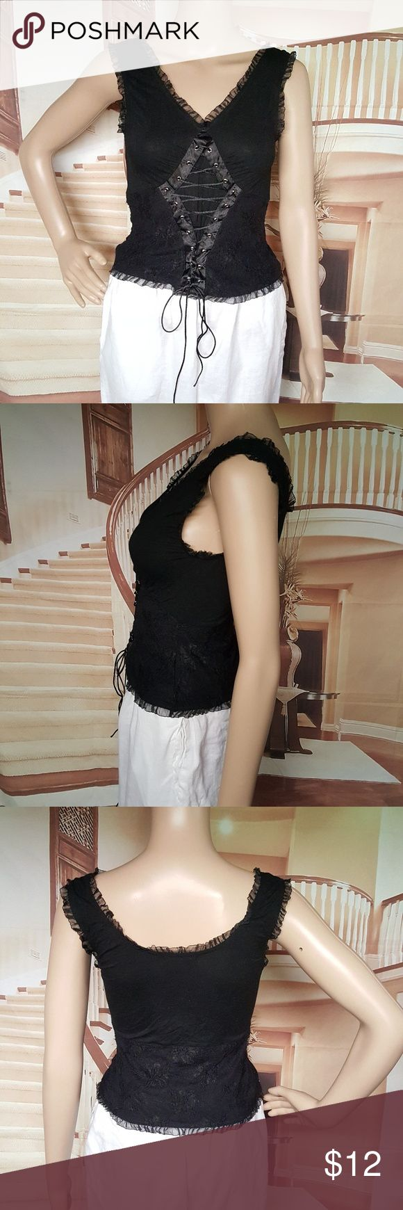 """Venus Cotton Black Corset Style Tank Top Sz M This is a beautiful cotton spandex blend sleeveless top. As you can see from the pictures it has a set on the corset. The sleeves are trimmed with a delicate lace. This is a snug fitting lightweight item and will make a beautiful addition to your summer wardrobe.  Length 19"""" Chest 28"""" Waist 26"""" Hips 30""""  Condition- There are no stains, tears, holes, loose strings, damage, defect venus Tops Tank Tops"""
