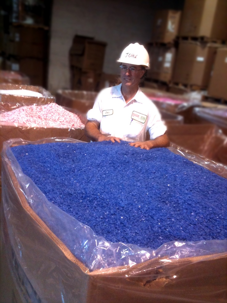 Recycling Solution's Plant Supervisor John Flannery prepares an outbound shipment of recycled plastic. These gaylord boxes of recycled regrind and pellets are used in plastic injection molding and extrusion machines.    If it was not for companies like Recycling Solutions, plastic scrap would fill up land fills instead of finding their way back into the manufacturing supply chain.