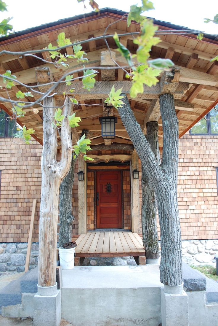 Timber Frame Entryway on our Osaka Home #TimberFrame #Log #Custom #Accent #Osaka #DiscoveryDreamHomes
