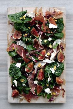 Fig, Arugula Prosciutto, Pistachios, and Goat Cheese Salad. Perfect served on a platter to share with friends at a dinner party