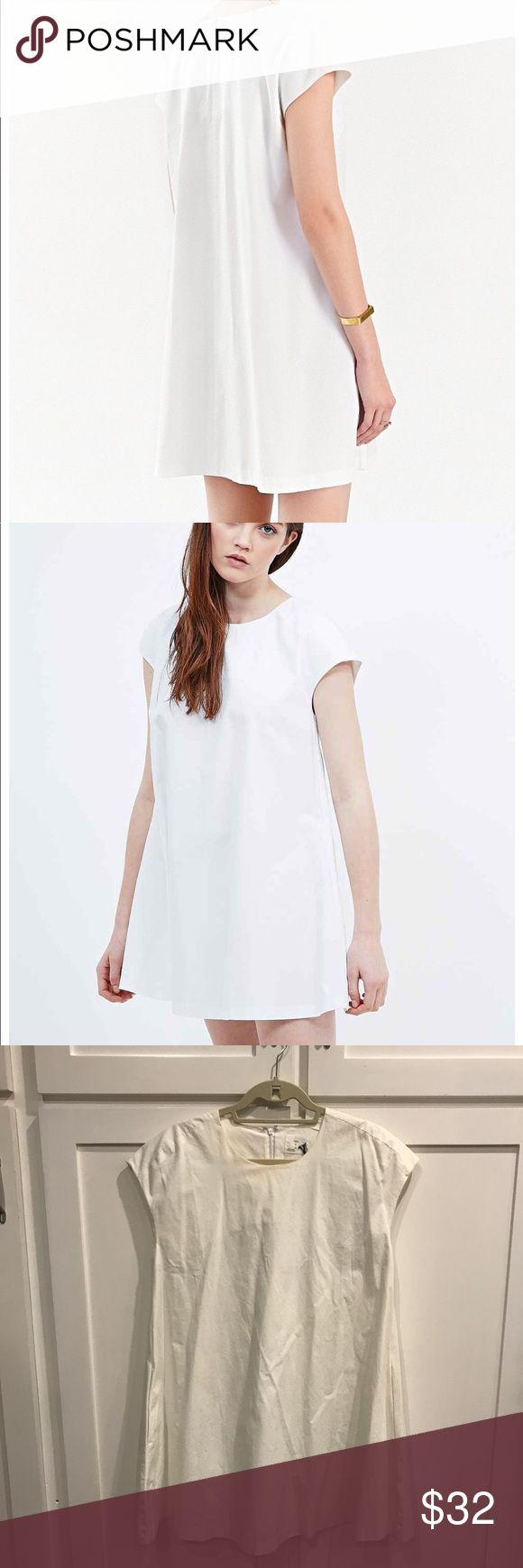 "White ""Half Moon"" mini shift dress Simple easy mini dress/tunic by Alice for urban outfitters. Simple crew neck line, pockets, hits mid thigh, back zip, slight trapeze shape. Faint yellowing by neckline though price reflects. Never worn, tags attached. 31"" from shoulder to hemline. 30"" across chest. Happy to wash before shipping though tags will be detached (I can include in package of you want) Urban Outfitters Dresses Mini"