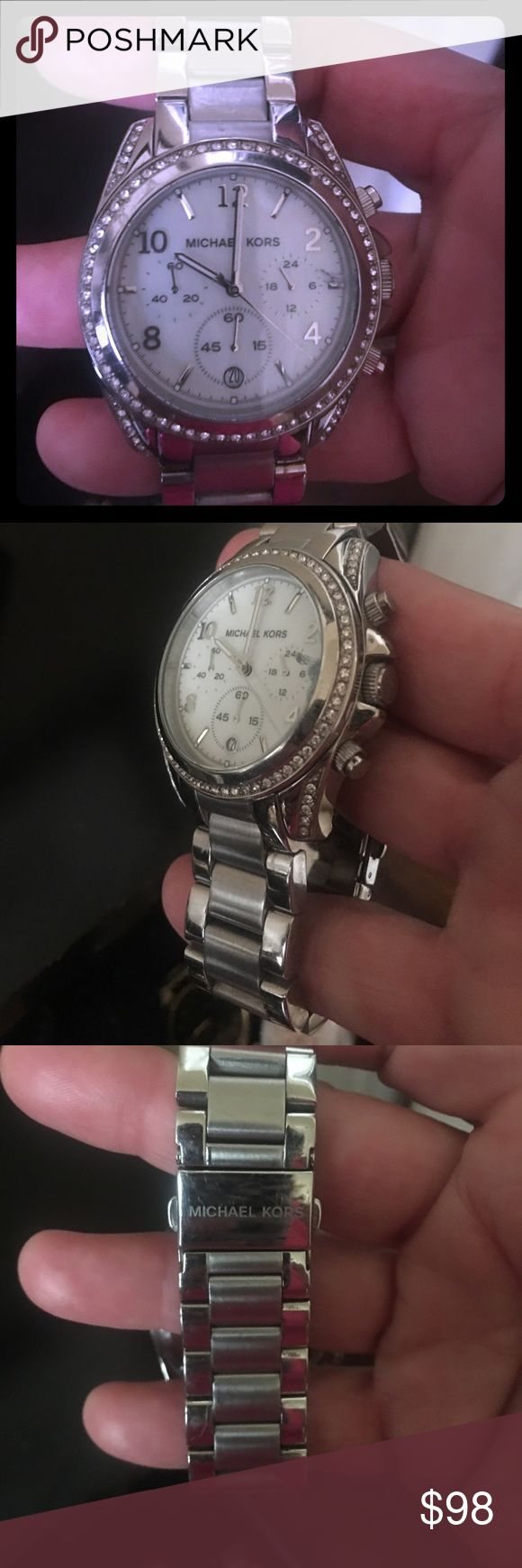 Michael Kors ladies silver watch w/stone detail Michael Kors ladies silver watch w/mother of pearl face. Watch is in brand new condition. KORS Michael Kors Accessories Watches