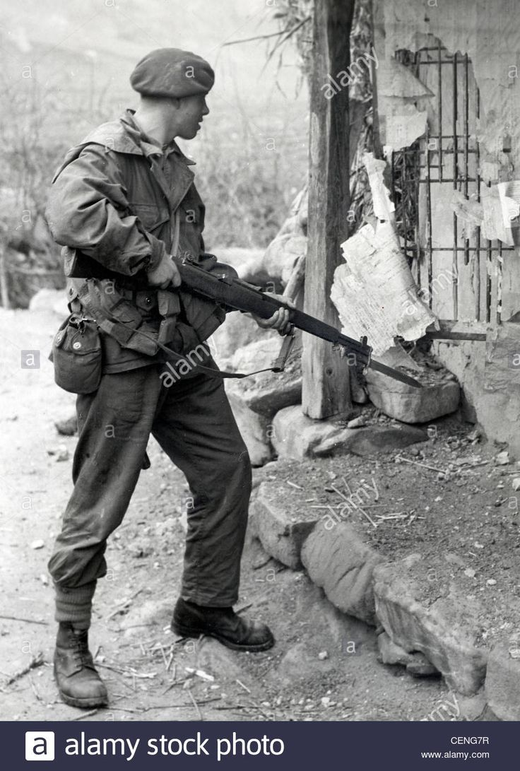Royal Marine Commando in action in the Korean War armed with an American Garand…